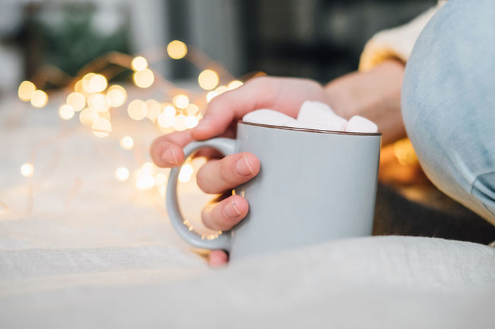 Woman holding cup Cocoa Marshmallows Beverages Christmas Christmas Lights Copy Space Food And Drink Hot Beverage Light Marshmallows Cacao Close-up Cocoa Coffee Cup Cozy Cozy At Home Cozytime Focus On Foreground Holding Human Body Part Human Hand Leisure Activity Lifestyles Low Section One Person Real People Women