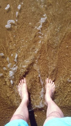 Relaxing on the Beach. Having great Holidays. Sun Sand Barefoot Lifestyles Water Vacations Sea Nature Standing People Men Human Leg