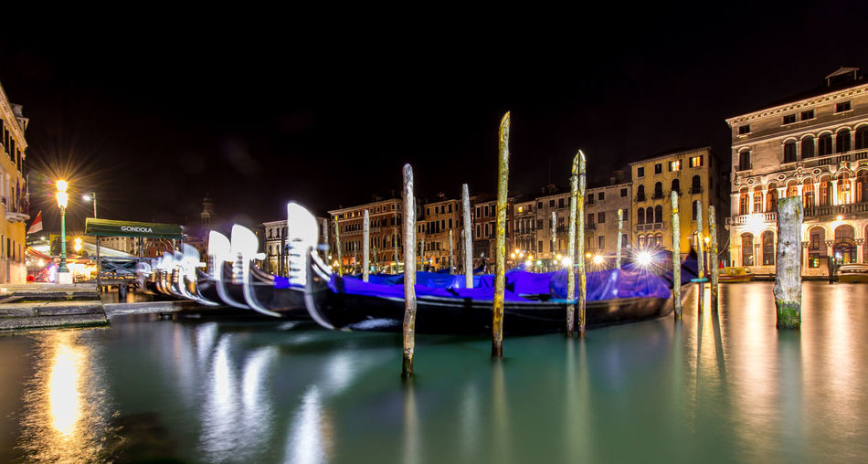 Gondolas moored in grand canal at night