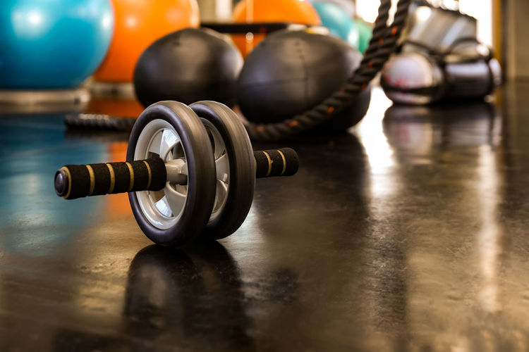 Closeup of a fitness equipment in gym. exercise wheel in a gym. fitness roller equipment.
