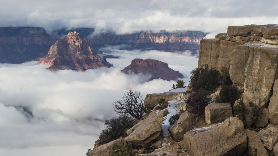 Grand Canyon Travel Photography Outdoors Winter Beauty In Nature Scenics Mountain Arizona Landscape Grand Canyon National Park Rock Formation Physical Geography Power In Nature Nature Atmospheric Mood Travel Fog Winter Cloud - Sky Red Colorful Nature Exploring Vacations Travel Destinations