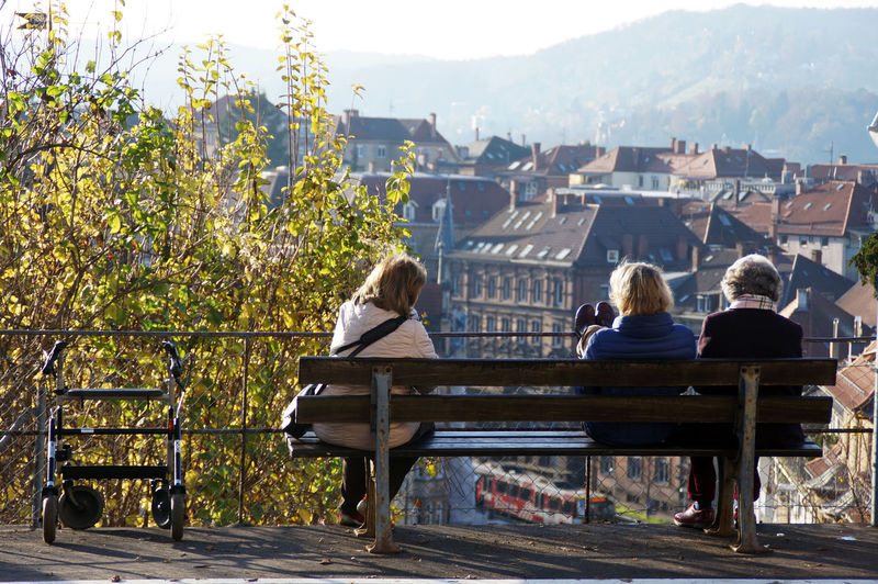 Three older ladies sitting on a bench and enjoy the view of the old city - Stuttgart Architecture Autumn Autumn Colors City View  Old Old Ladies Old Ladies Talking Togetherness