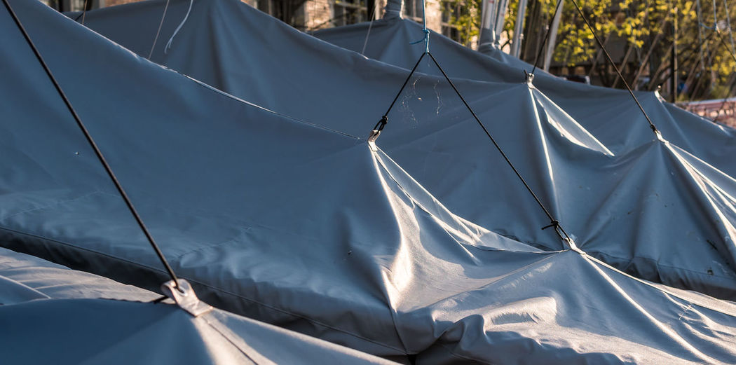 Tarps over parked sailboats. Sailboats Tarps Nature Day Sunlight No People Tent Outdoors Environment Transportation Water Sport
