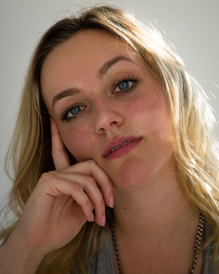 Adult Beautiful Woman Beauty Blond Hair Close-up Contemplation Front View Hair Hairstyle Headshot Human Face Indoors  Leisure Activity Lifestyles Looking At Camera One Person Portrait Real People Teenager Women Young Adult Young Women