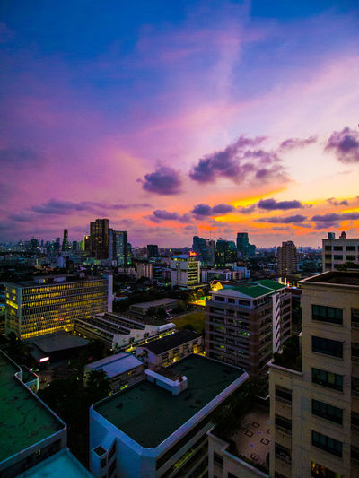 High angle view of illuminated cityscape against sky during sunset