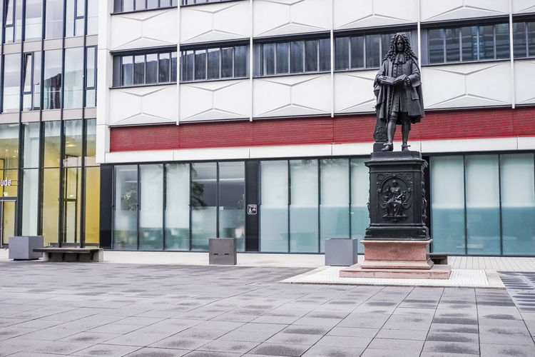 Statue of Gottfried Leibniz at the University campus in Leipzig, Germany. Gottfried Leibniz Statue Architecture Building Exterior Built Structure Day Human Representation Leibniz  Mathematician Monument No People Outdoors Philosopher University