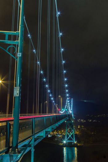 Lions Gate Bridge, Vancouver, at night Night Illuminated Bridge - Man Made Structure Connection Architecture Built Structure Transportation Sky Suspension Bridge Outdoors Travel Destinations No People Road Low Angle View Water City Lions Gate Bridge Vancouver Light Trails Lights Tourism British Columbia Landmark Iconic Side Angle Connected By Travel