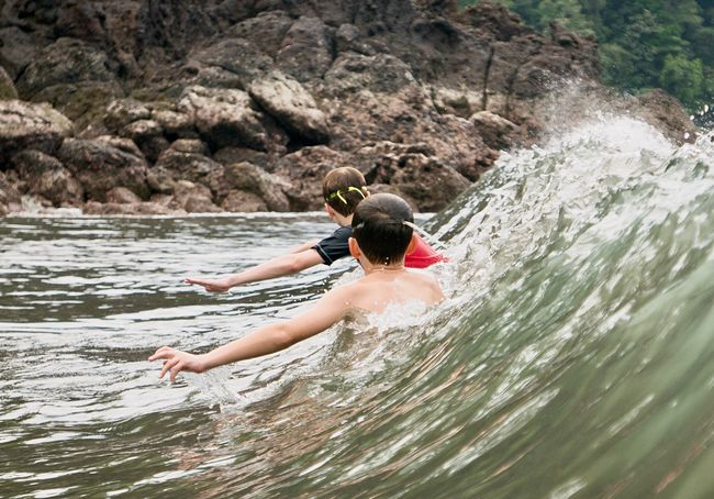 Body surfing Costa Rica Beach Body Surfing Kids Fun Catching Waves Waves Adventure Day Fun Motion People Outdoors Water