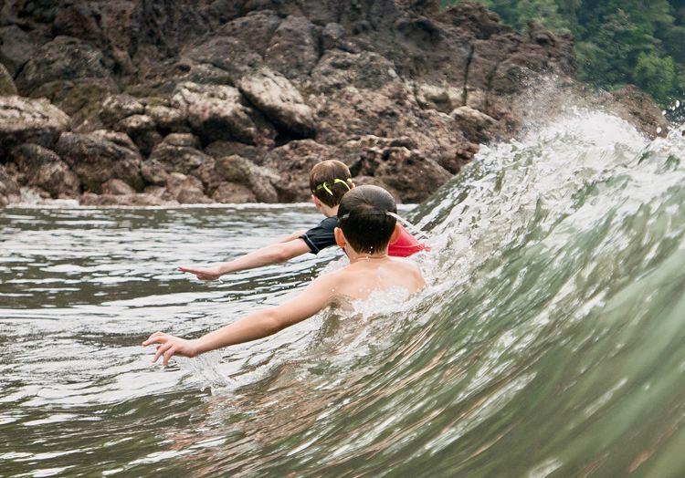 Boys enjoying in waves
