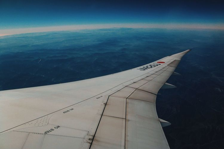 Air Airpolution Airplane Transportation Flying Aerial View Aircraft Wing Beauty In Nature Travel Nature Air Vehicle Airplane Wing Journey Scenics Sea Tranquil Scene Sky Day No People Outdoors Landscape