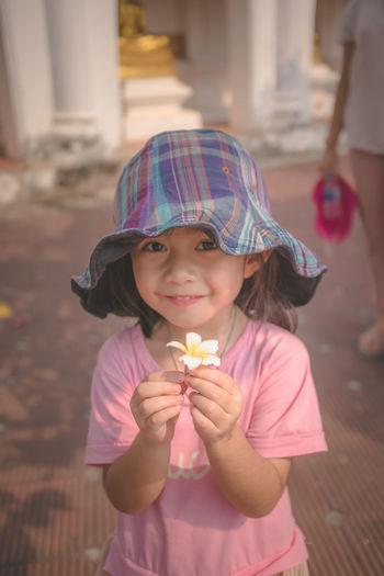 Portrait of a cute lttle girl with flower