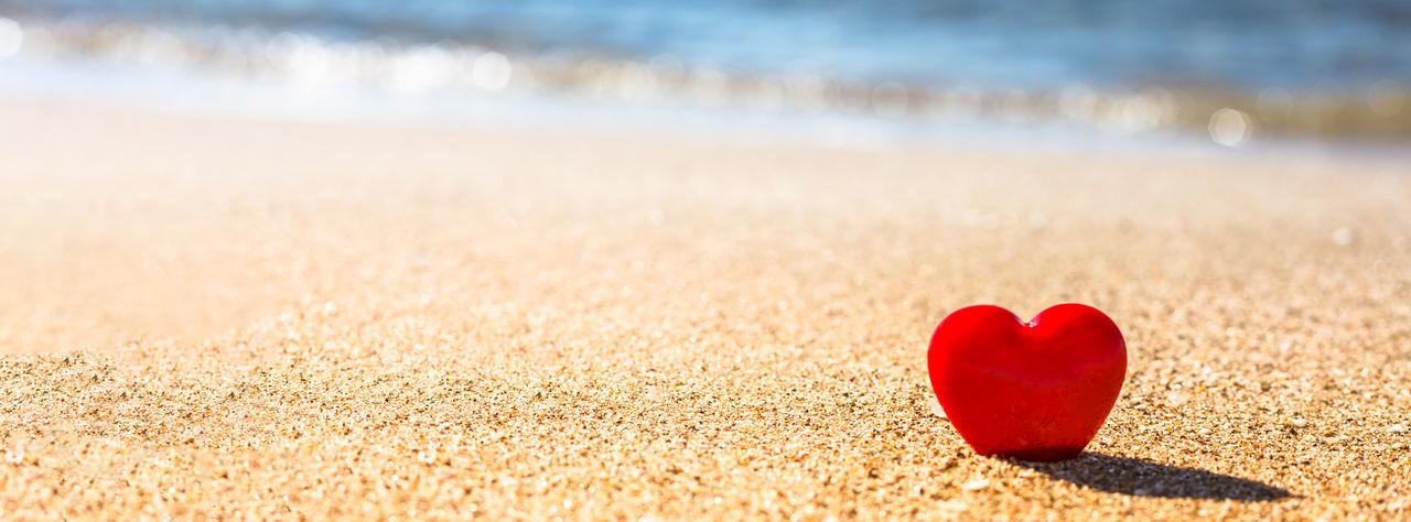 Close-up of heart shape on sand