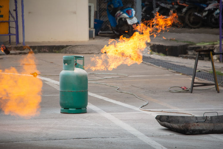 Burning Firefighter Fuel Gas Plant Security Accidents And Disasters Bottle Burn Burning Conflagration Fire Fire Extinguisher Gas Leak Gas Tank Heat Heat - Temperature Nature Petrochemical Rehearsal Safety Smoke - Physical Structure Street Training Warning Sign