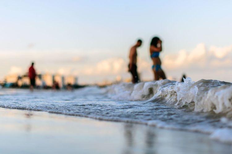 Close-Up Of Sea Waves Rushing Towards Shore