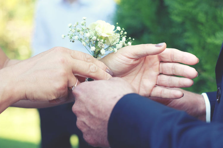 Adult Adults Only Bride Close-up Day Flower Holding Human Body Part Human Hand Life Events Lifestyles Love Men Outdoors People Real People Senior Adult Togetherness Two People Wedding Ceremony Wedding Ring Women