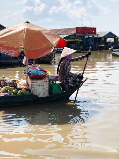Man sitting in boat at market