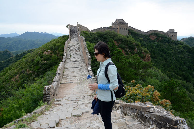 High angle view of a woman standing on great wall of china