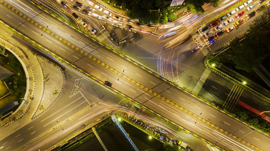 Transportation Road City Architecture Mode Of Transportation Car Motion High Angle View Motor Vehicle Land Vehicle Built Structure Illuminated City Life Traffic Long Exposure Speed Night Street Connection Highway Light Trail No People Bridge - Man Made Structure Multiple Lane Highway Outdoors