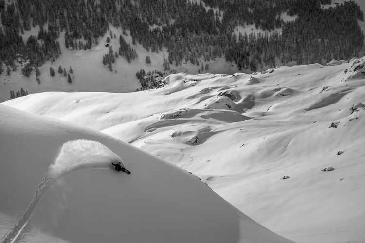 High Angle View Of A Distant Person Snowboarding