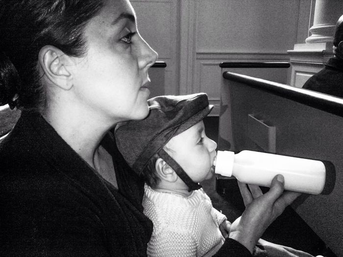 The Portraitist - 2014 EyeEm Awards Fortheloveofblackandwhite EyeEm Best Shots - Black + White Eye4photography  At Church Black And White Portrait Mother And Child At The Funeral From My Point Of View