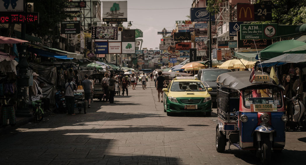 Khao San Road Bangkok, Thailand Architecture ASIA Asian  Bangkok Building Exterior Built Structure City Day Daylight Khoasanroad Land Vehicle Large Group Of People Men Mode Of Transport Outdoors People Real People Sky Street Streetphotography Taxi Thai Thailand Transportation Tucktuck