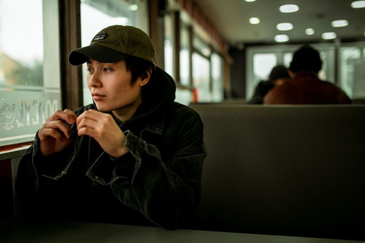 diner dash Diner Booth Men Sitting Window Contemplation Hooded Shirt Hood - Clothing Thoughtful Pensive Introspection Asian  Thinking