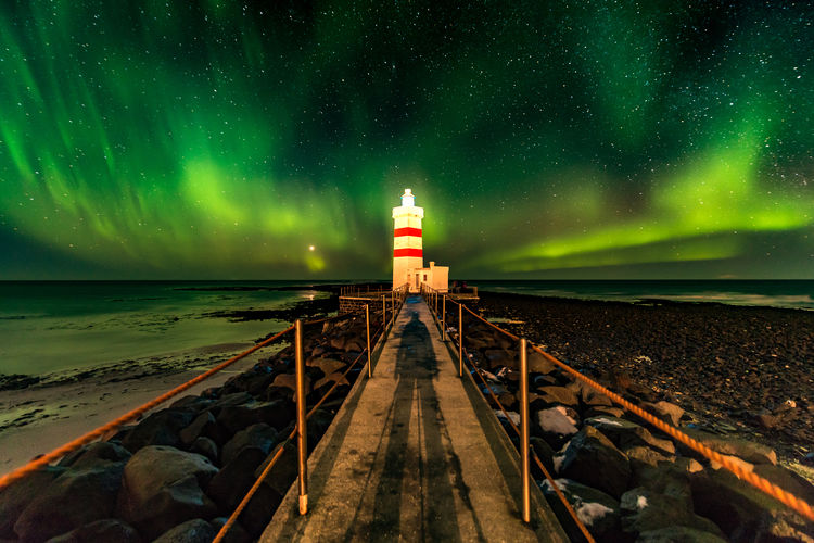 """""""So, where are the lights?"""" In the south west of Iceland, you can find the Gardur lighthouse. With a bit of luck you will be able to experience the aurora here, as I did on the first night of my latest Icelandic journey. This location can be hard to photograph after the coaches with Chinese and American tourist arrive. One friendly American lady came up to me and asked me: """"The guide took us here on an aurora tour. So where are the lights? Do you know where we should go to see it?"""" """"Erm... yes, I do."""" Astronomy Aurora Aurora Polaris Beach Copy Space Gardur Garður Horizon Over Water Iceland Illuminated Journey Landscape Lighthouse Long Exposure Nature Night No People Northern Lights Outdoors Scandinavia Scenics Sea Space Space And Astronomy Travel The Secret Spaces The Great Outdoors - 2017 EyeEm Awards Neighborhood Map Live For The Story Lost In The Landscape Shades Of Winter Go Higher Inner Power HUAWEI Photo Award: After Dark Capture Tomorrow Humanity Meets Technology"""