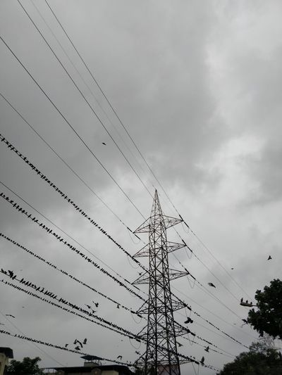 Built Structure Cable Cloud - Sky Connection Day Electrical Equipment Electricity  Electricity Pylon Fuel And Power Generation Industry Low Angle View Nature No People Outdoors Overcast Power Line  Power Supply Sky Tall - High Technology