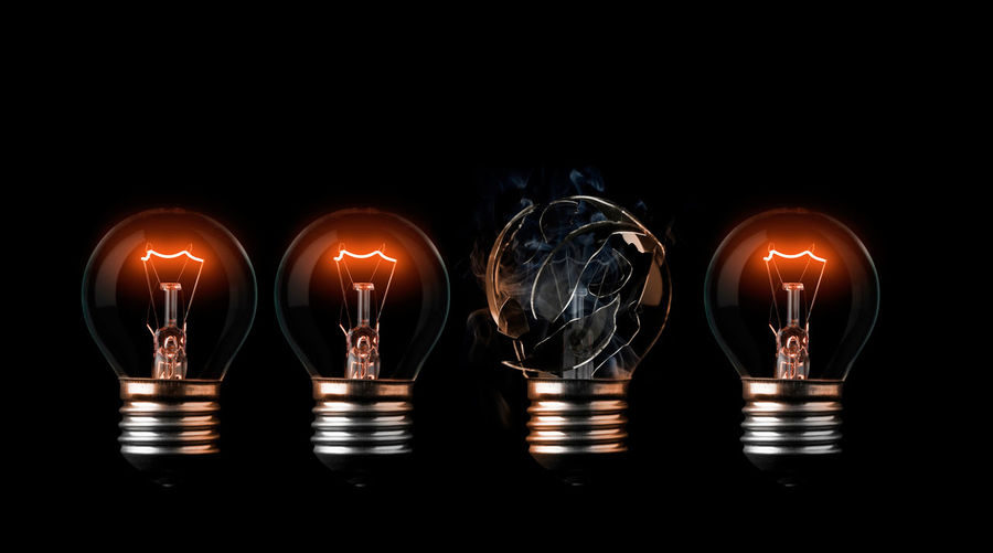 One burn out light bulb in a row of good one Broke Explosion In A Row Light Broken Burn Out Burst Concept Conceptual Destroyed Exploding Fail Filament Idea Illuminated Incandescent Light Bulb Loss Overpower Progression  Replace Row Sequence Tungsten  Turn On