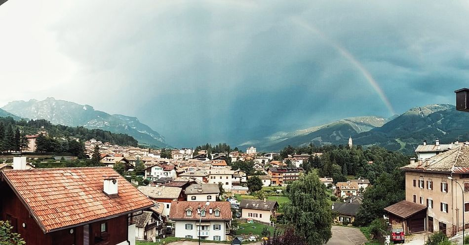 Raimbow Taking Photos Hanging Out Relaxing Enjoying Life Backhome Thinking Mountains And Sky Mountains Mountain View Houses Little Town Green Trees Fields Plants Flowers Sunrise Cluods  Clouds And Sky Rainy Days Drops Drop Be Happy Travel