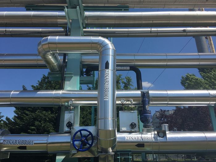 Low Angle View Of Pipes Against Clear Sky