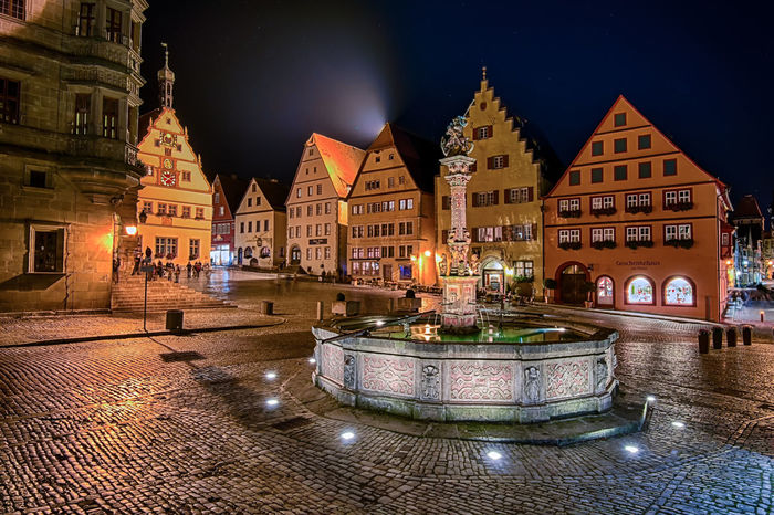 Once Rothenburg turned on its light, it was love at first sight. Architecture Illuminated Outdoors Colourful European Architecture Architecture_collection Architecture Multi Colored Travel Destinations Europe City City Life Night Lights Night Photography Town Village TOWNSCAPE Rothenburg Ob Der Tauber Germany Deutschland Long Exposure Water Fountain Well  Bavaria