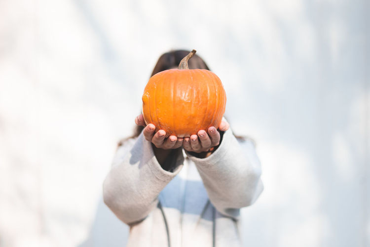 Autumn Mood Food And Drink Food Freshness One Person Healthy Eating Holding Orange Color Pumpkin Fruit Vegetable Focus On Foreground Day Wellbeing Close-up Halloween Nature Autumn Human Hand Hand Single Object Outdoors