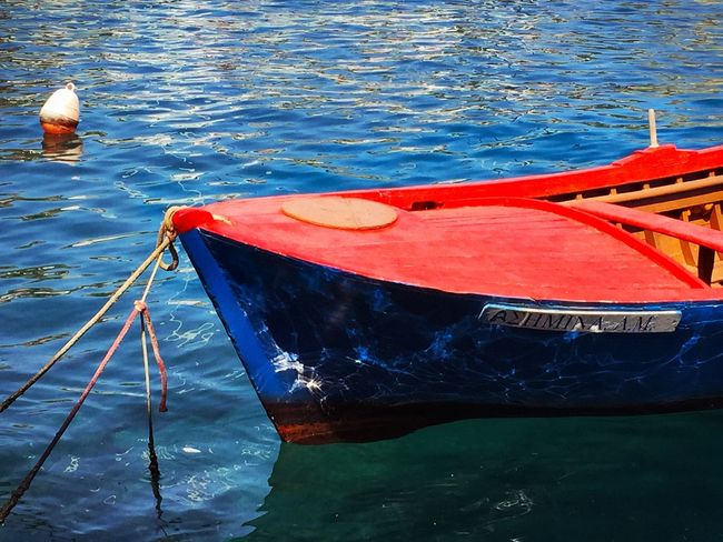A little boat in Greece, my first real meaningful picture 😍 My Best Photo 2015 Holidays Greece MEIS Sun Boat Water Sea Blue Red Reflects