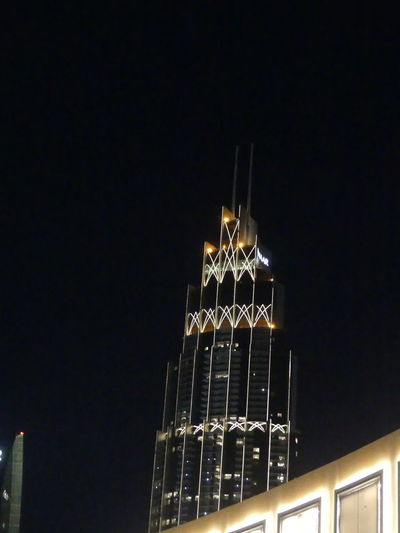 Another Emaar Tower at Night, Dubai, United Arab Emirates 2019 Dubai UAE 2019 Night Low Angle View No People Black Background City Tall - High Skyscraper Tower Tower Block  White Light Modern Design Glass And Steel Structure Illuminated Building Exterior Building Facade Composition Outdoor Photography Night Photography Tourist Destination Emaar Travel Destinations Travel