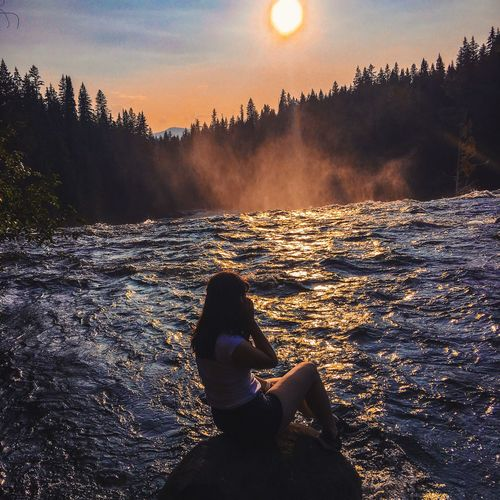 Down by the river Photooftheday Beautiful Nature Waterfalls Photographer Real People Sky Sunset Water Nature Lifestyles Silhouette Land Plant Tree Outdoors Beauty In Nature Sunlight People