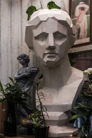 Statue of potted plant