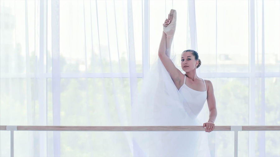 Portrait of ballerina dancing in dance studio