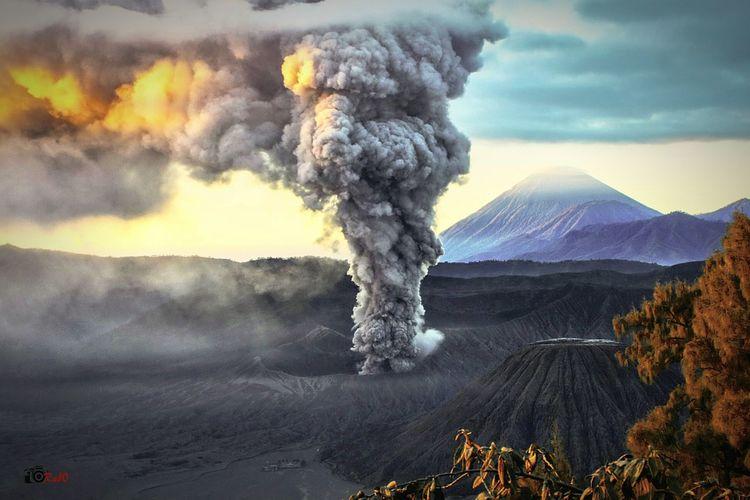Volcano erupting in landscape