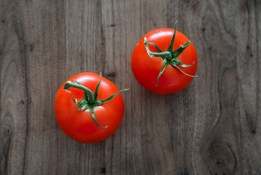 Red Tomatoes from above Close-up Cutting Board, Day Focus Food Food, Fresh, Freshness Grain, Healthy Eating Market, Missions Nature No People Organic, Overhead Red Sharp Tomatoes, Tradition Vegan, Vibrant, View Wood - Material