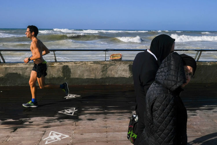 Israeli Winter Streetphotography 2018 In One Photograph Water Sea Beach Togetherness Full Length Sport Men Sand Friendship Young Women