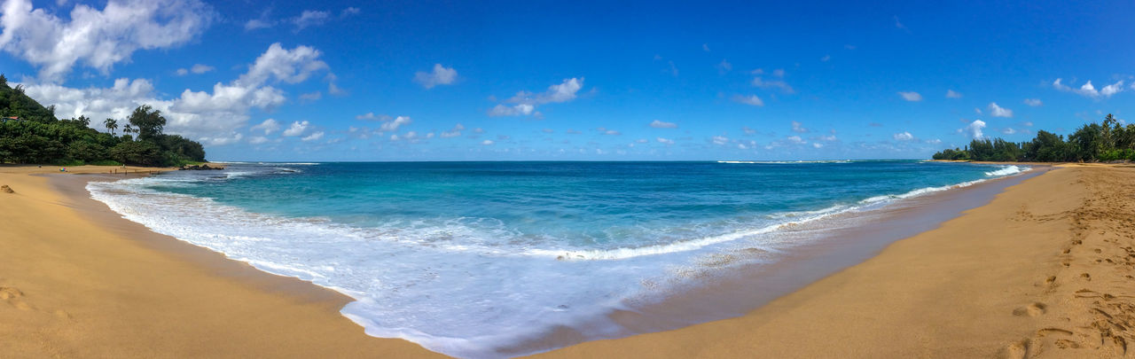 Panoramic view of haena beach park with tunnels beach makua beach, kauai, hawaii against sky