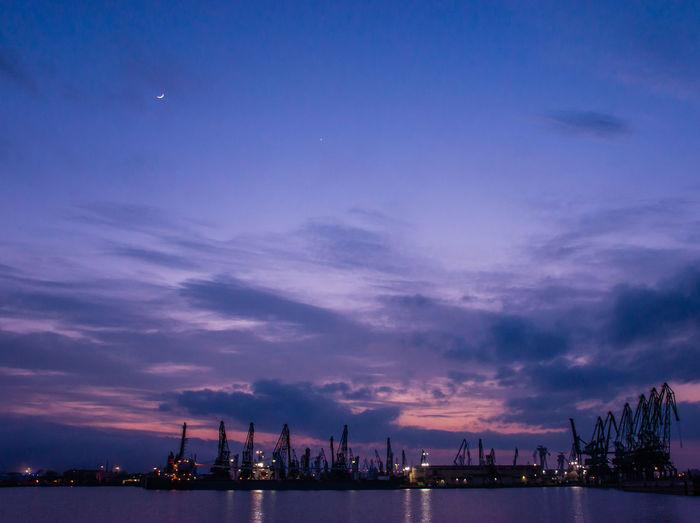 Harbor against sky at night