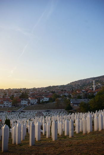 View of cemetery against clear blue sky