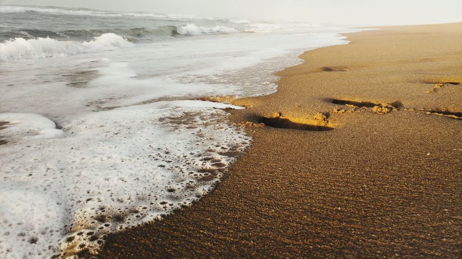 Beach Sand Sea Nature Shore Surf Wave Water Beauty In Nature High Angle View Motion Day Wet Outdoors Close-up South Africa Sunset Photography Themes Coastal Feature Travel Destinations Eyeemphoto Footprints