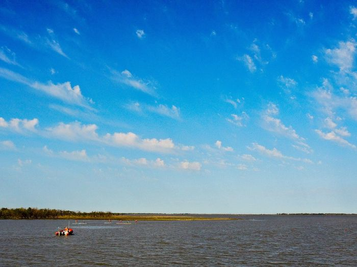 a nice sky with some couds at the river Argentina Beauty In Nature Blue Boat Carefree Cloud Cloud - Sky Day Idyllic Nature Non-urban Scene Ocean Outdoors Scenics Sea Sky Swimming Tourism Tourist Tranquil Scene Tranquility Vacations Water Waterfront Weekend Activities
