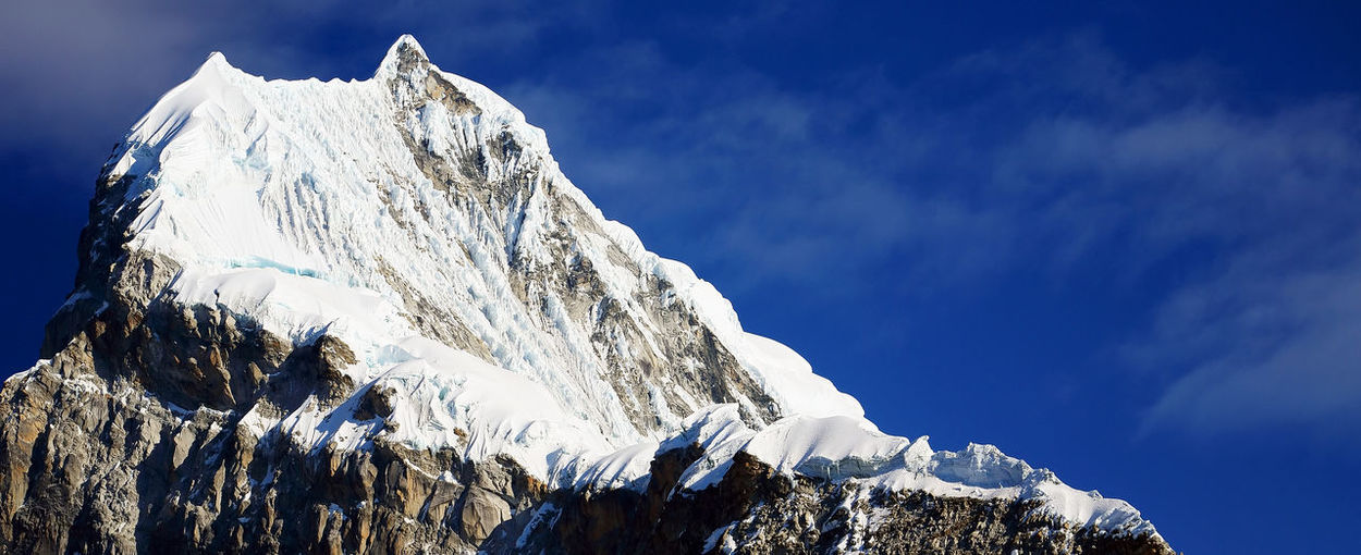 View Of Snowcapped Mountain Peak Against Sky
