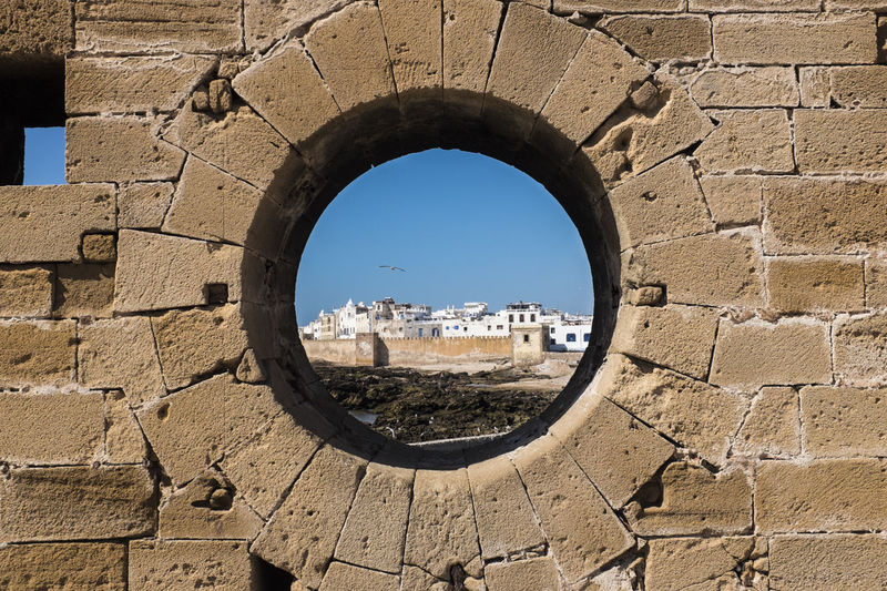 Old buildings seen through a round window
