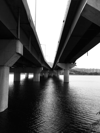 Fine Art Photography Architecture Under The Bridge Riverside Water Road Cityscapes City Life Urban Geometry Shades Of Grey Blackandwhite Monochrome IPhoneography Light And Shadow Showcase July