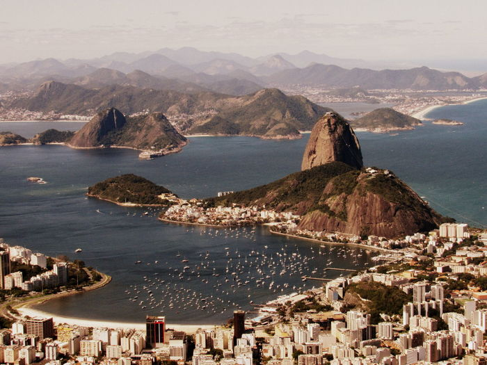 Baía De Guanabara Corcovado Pão De Açucar Sugar Loaf Architecture Beauty In Nature Building Exterior Built Structure Christ The Redeemer Day Enseada De Botafogo Mountain Mountain Range Nature No People Outdoors Physical Geography Scenics Sea Sky Tranquility Travel Destinations Water